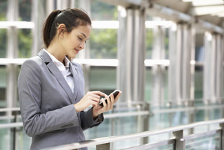 Image of woman entering information on mobile device