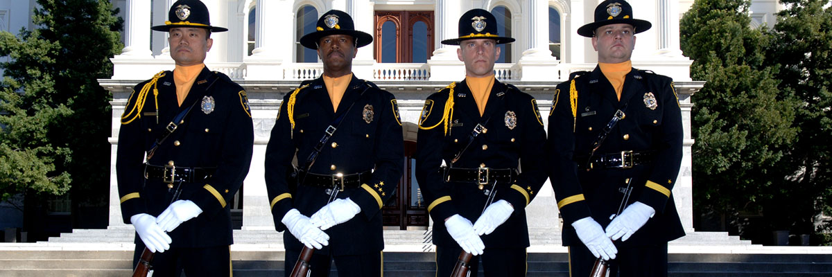 Special Agents Representing the Honor Guard Stand in Formation