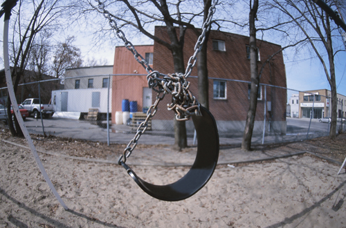 Tangled, metal swing set.